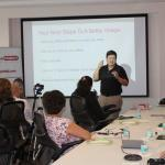 Carlos Garcia of Please Hold Advertising speaks at Lunch & Learn event in Miami, FL.